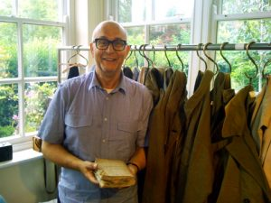 &quot; Nigel Cabourn in his studio with his father&#039;s journal from World War Two.&quot;